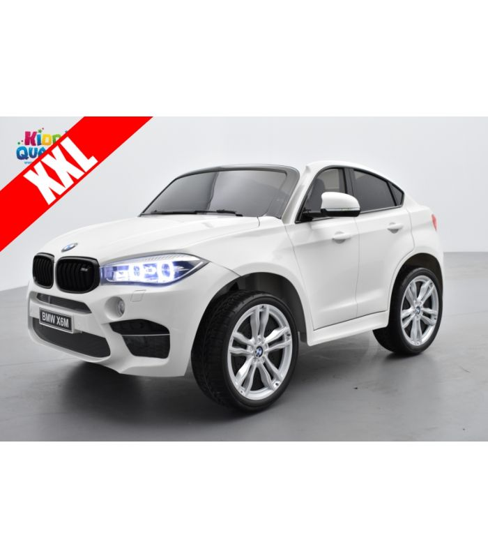 bmw x6 m blanc 2 places voiture lectrique enfant 12 volts 10ah 2 moteurs kiddi quad. Black Bedroom Furniture Sets. Home Design Ideas