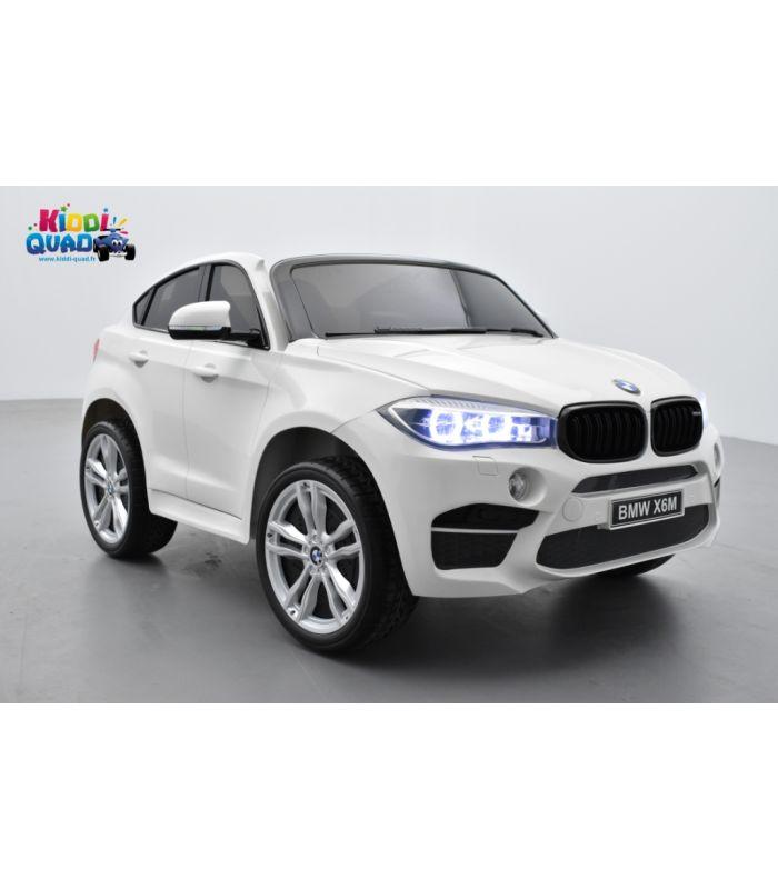 bmw x6 m blanc 2 places voiture lectrique enfant 12 volts 10ah 2 moteurs kiddi quad. Black Bedroom Furniture Sets. Home Design Ideas